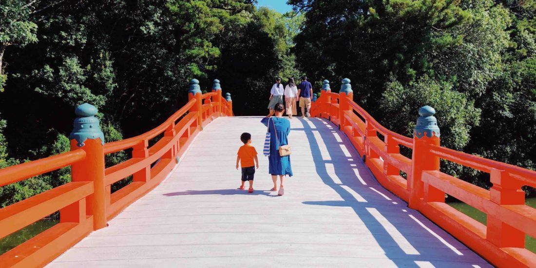 Mother and child on red bridge in Japan