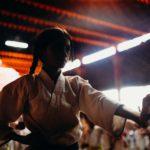 Karate class member in silhouette
